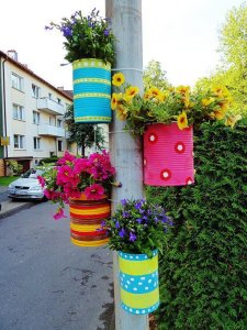 flower cans on pole